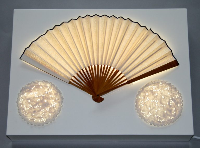 Go on, Spoil yourself 11x58x43cm [punctured fan, porcelain on light box]1