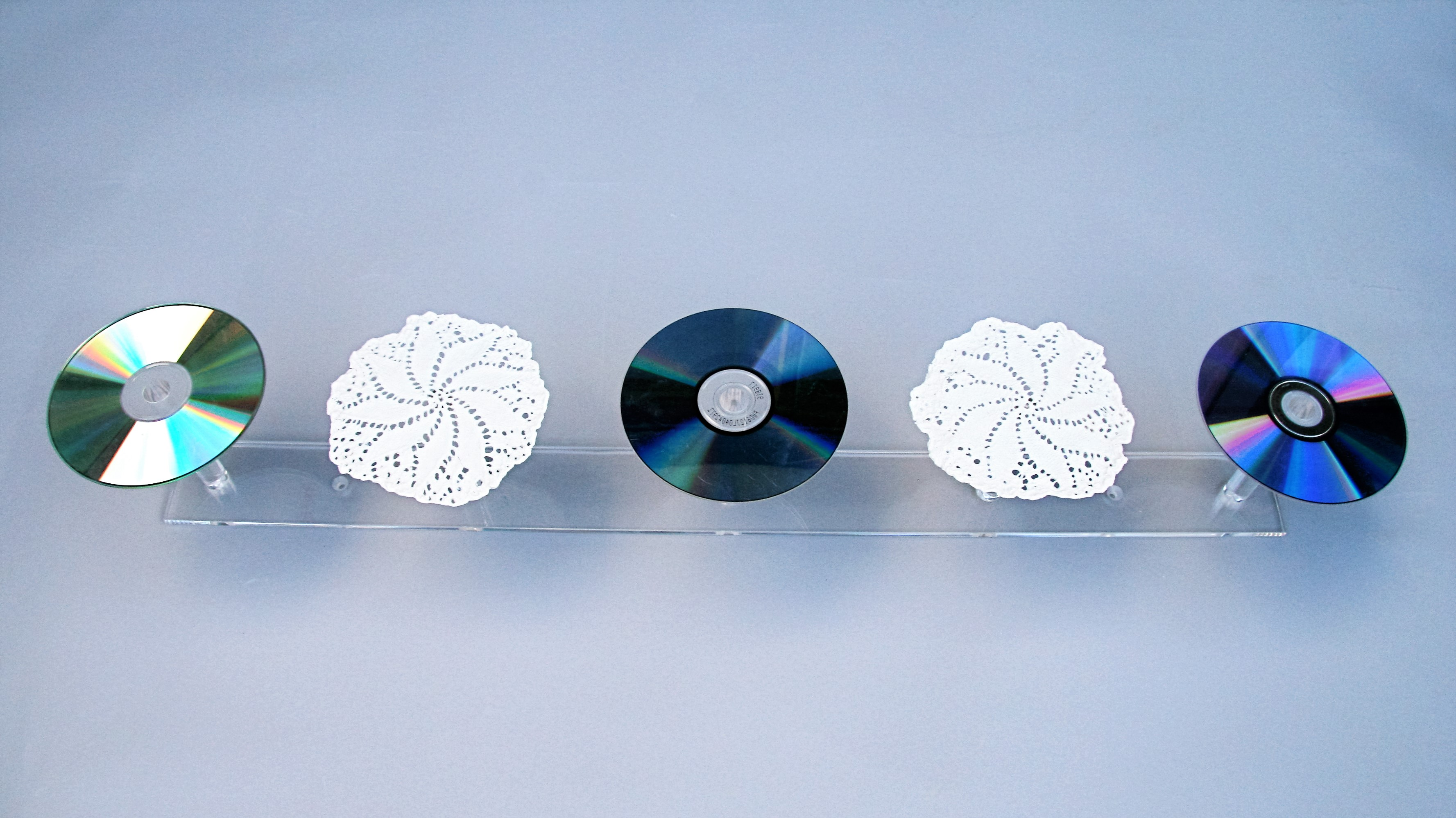 These and Those (are the Words of the Living G-d; Talmud Bavli Eruvin 13b, Gitin 6b) 12x10x78cm [porcelain, CDs, perspex] (2)